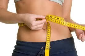 measuring tape around slim girls waist