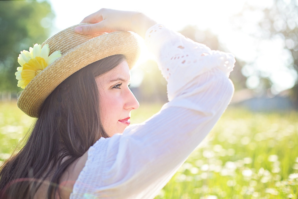 Girl in sunshine with a hat