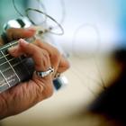 "<img src=""image.gif"" alt=""a man strumming a guitar />"